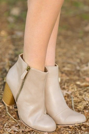 Taupe booties with side zipper detail! The perfect color! These can be worn with all your winter outfits! Must have!