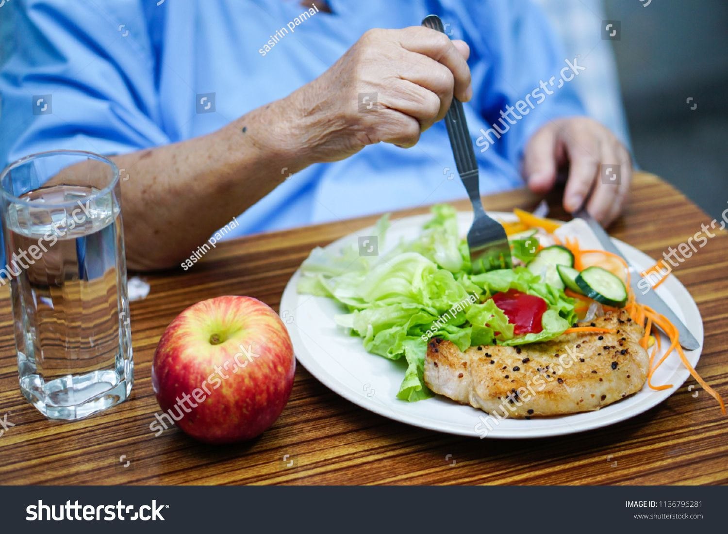 Asian Senior Or Elderly Old Lady Woman Patient Eating Breakfast