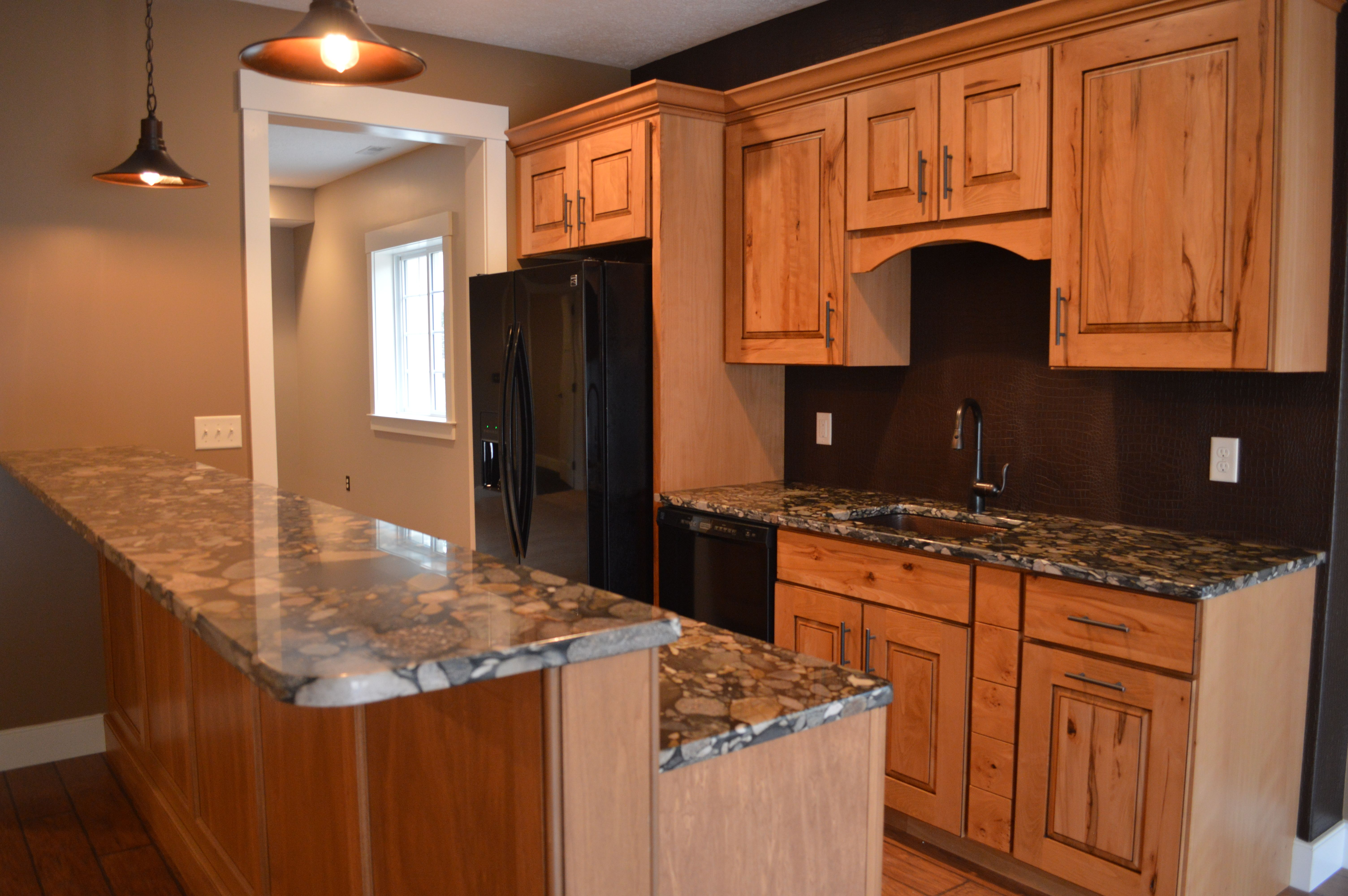 Cypress Cabinets And Granite Tops.