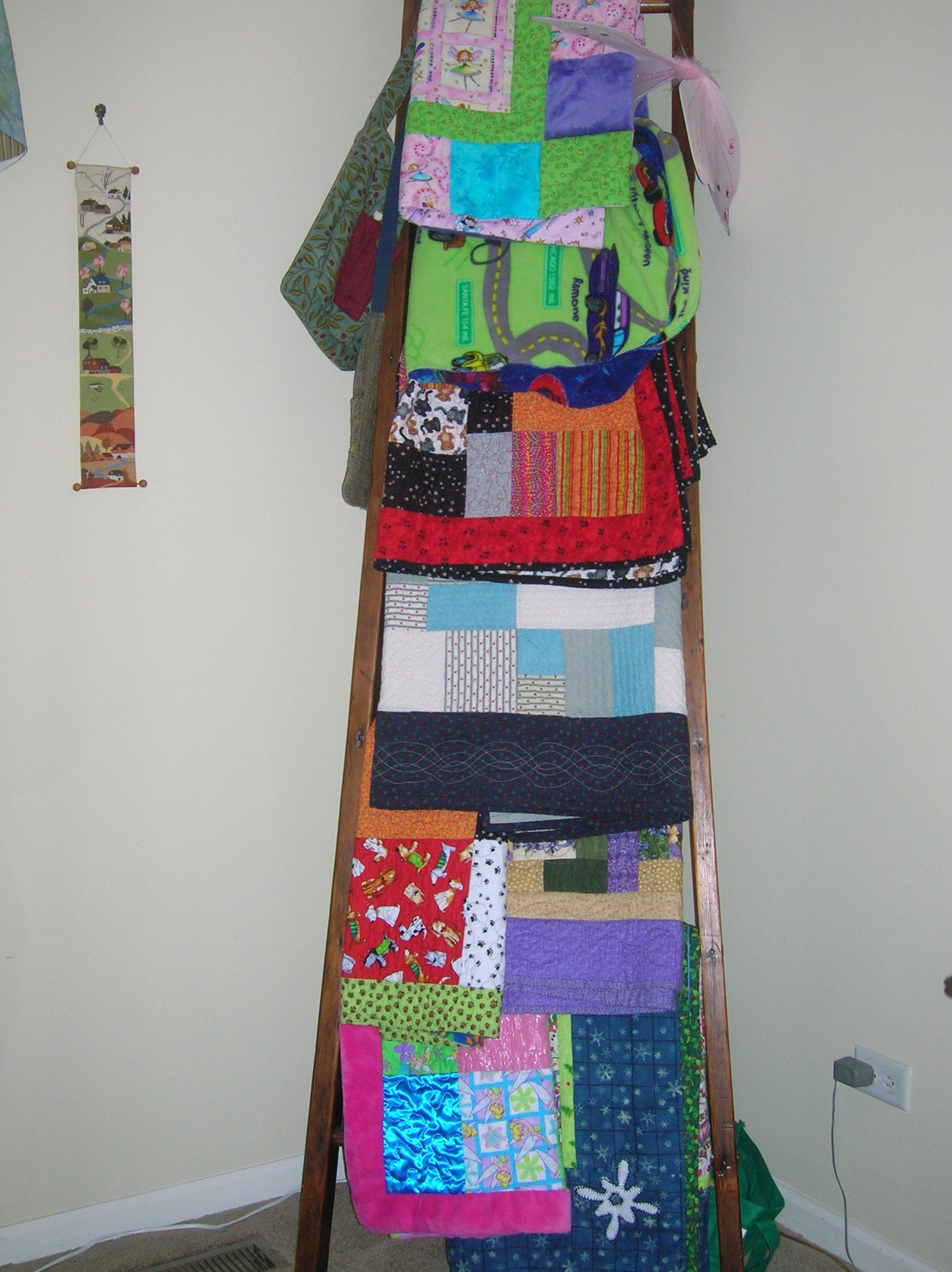 My former next-door neighbor made the perfect quilt hanger for my ... : we r quilts - Adamdwight.com