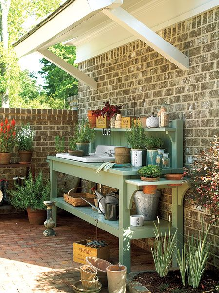 A potting bench with an outdoor sink keeps gardening projects
