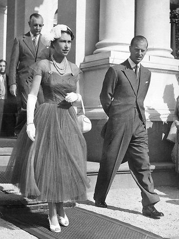 .Queen Elizabeth II and Prince Phillip at a a Royal Garden Party during their 1954 world tour.