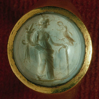 Gold ring, the projecting circular bezel set with a sardonyx intaglio of Abundantia with cornucopia and an eagle with a wreath, Roman, 1st or 2nd century