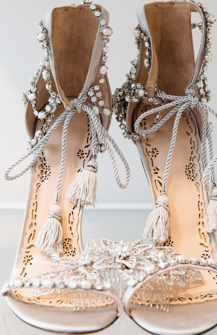 wedding sandals Marchesa bridal pearls sandals and it appears that there is a hair ornament or these shoes might have some bite