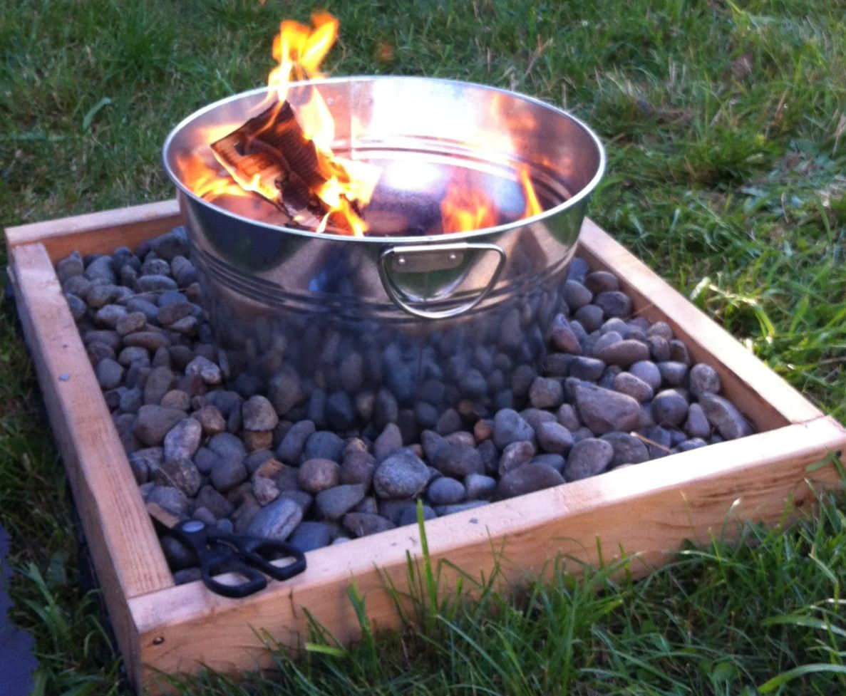 build a fire pit for around 50 supplies 1 large metal