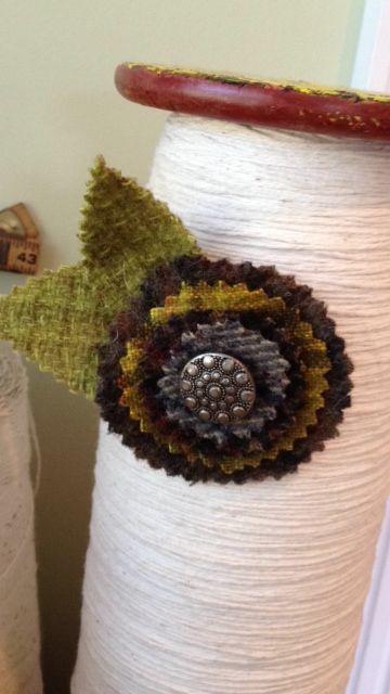 Cut circles from wool along with two leaves... add an antique button and a 'pin back'...
