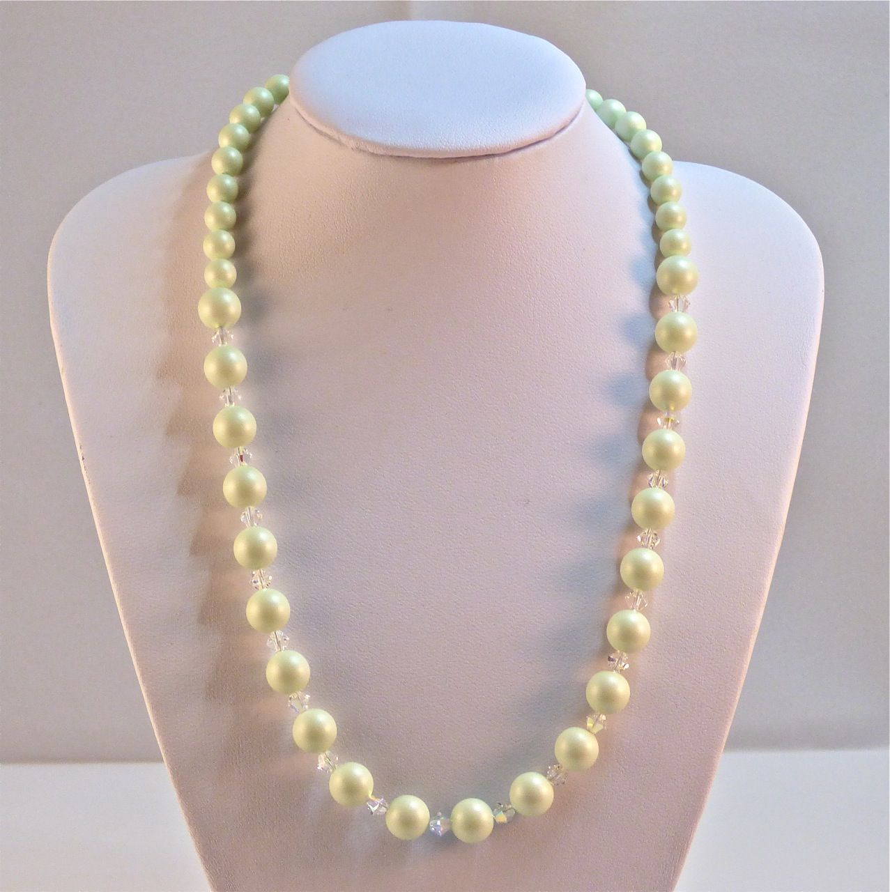 colorful pearls necklace beautiful chic pastel shells with sizes and sea shapes background pea of different photo