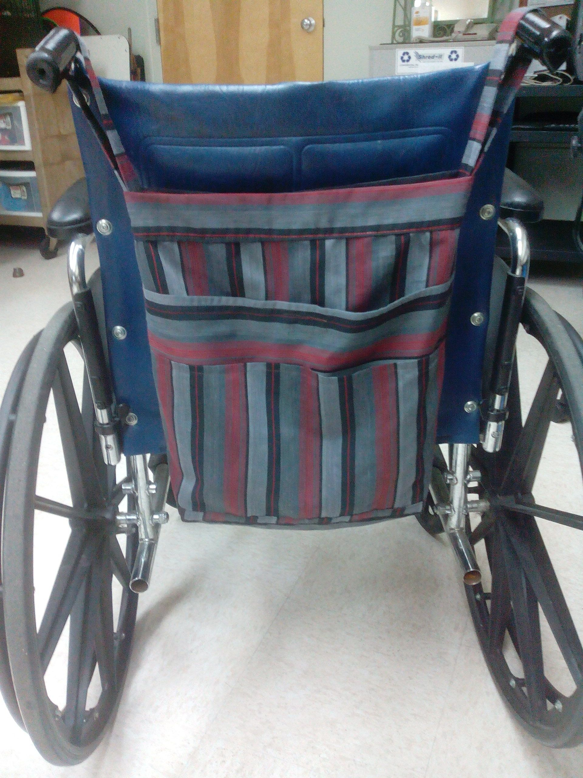 grey striped wheelchair tote bag with multiple pockets