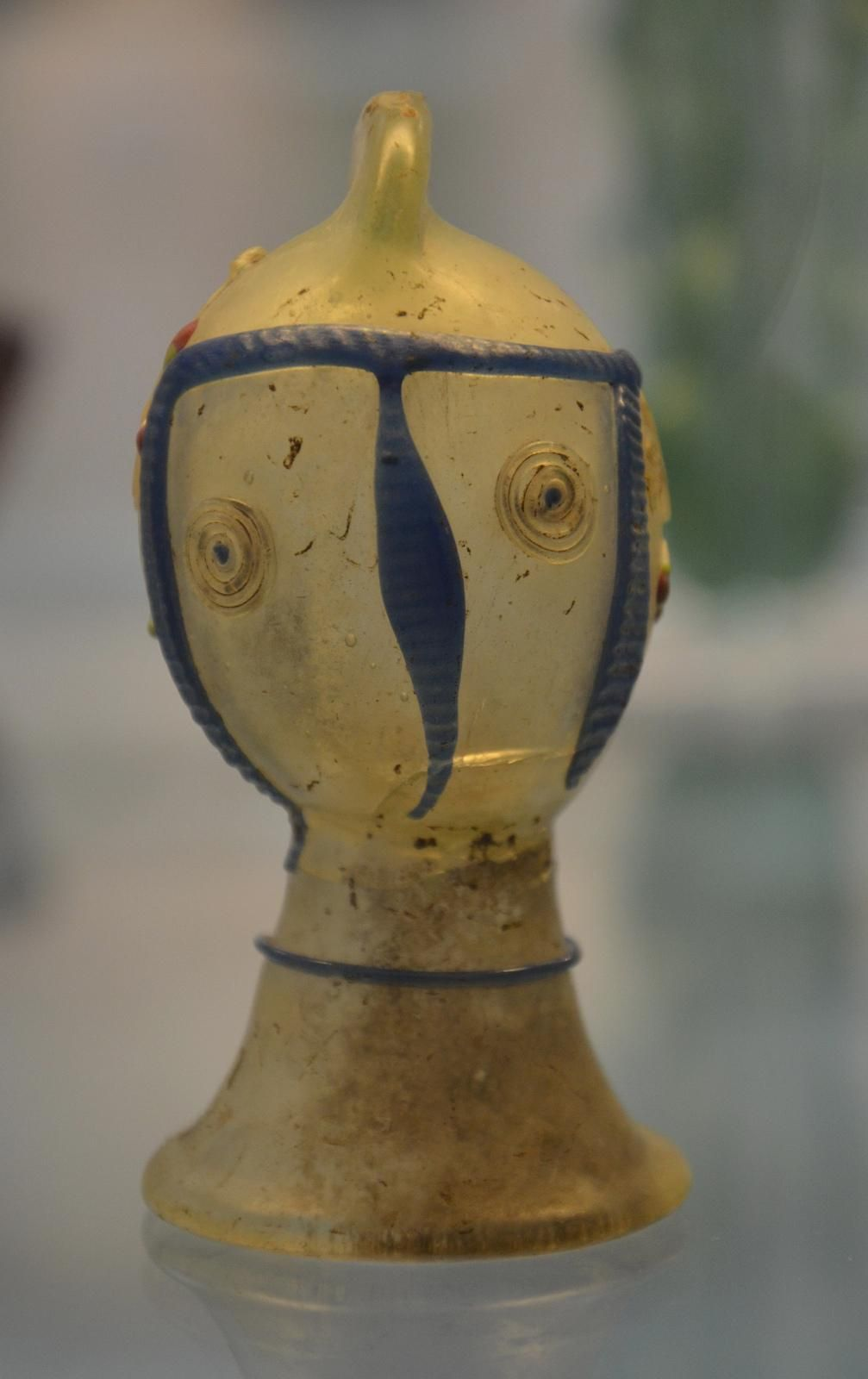@carolemadge gladiator helmet-shaped dropper flask decorated with snake thread trails, made in Cologne, 3rd c. AD #romanglass