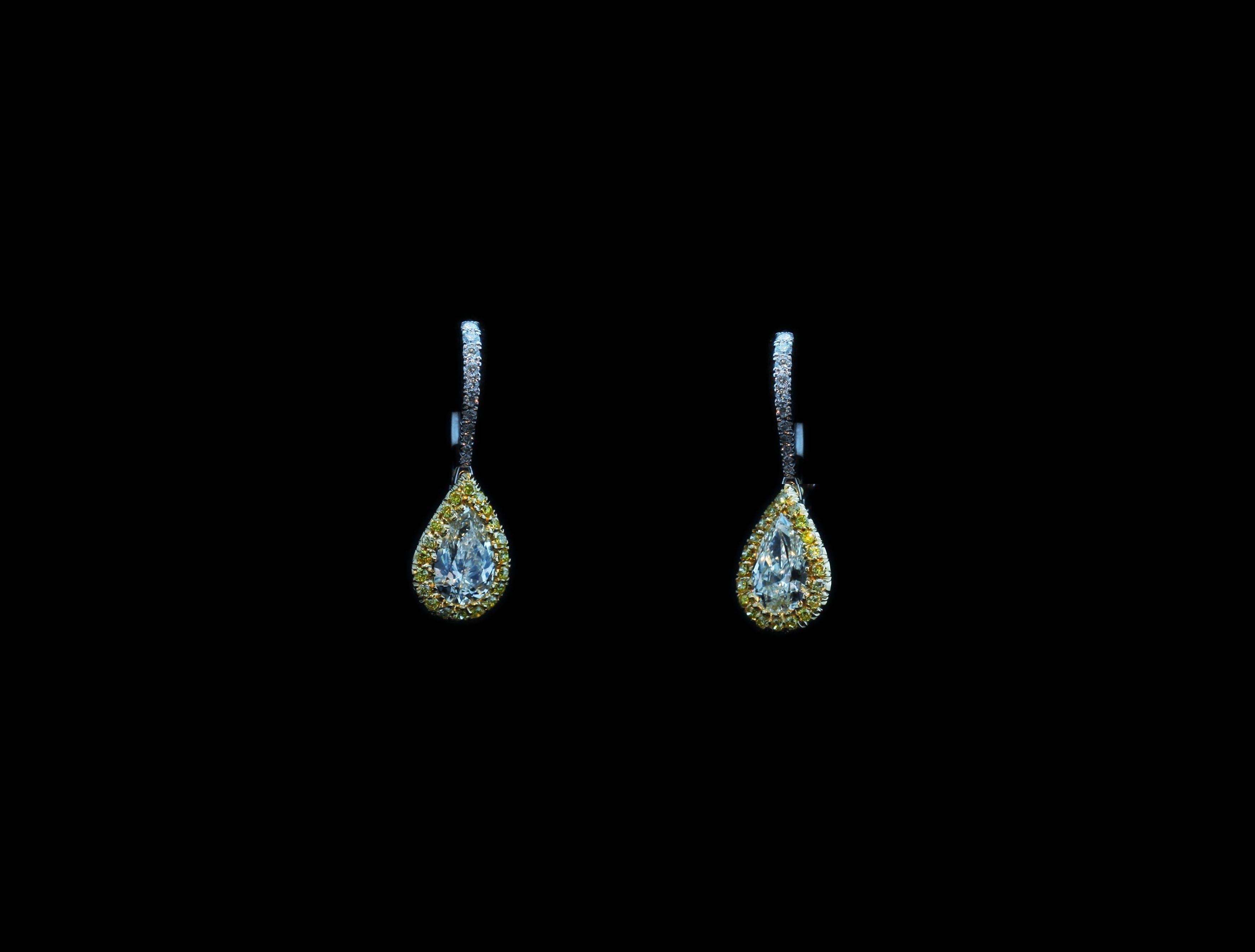 PEAR SHAPE DIAMONDS EARRINGS WITH FANCY INTENSE YELLOW DIAMONDS
