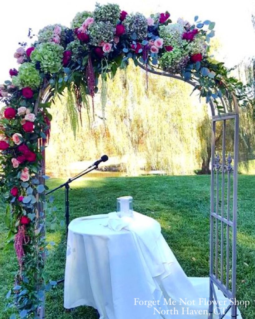Arch decorated with roses, Dutch hydrangea and greens for an ...