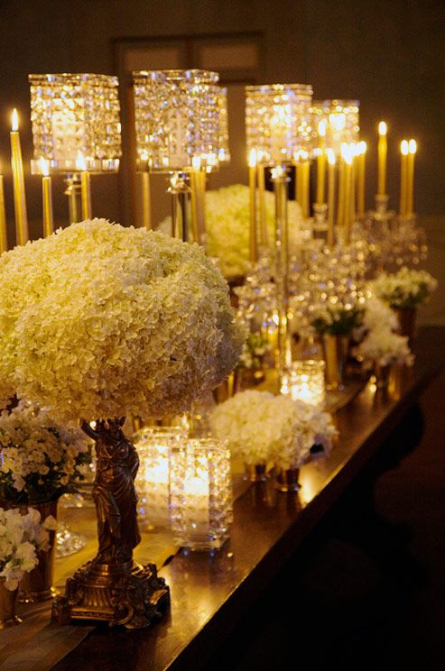 embellished candle holders perched on gold bases are matched by beautiful gold taper candles - Gold Candle Holders