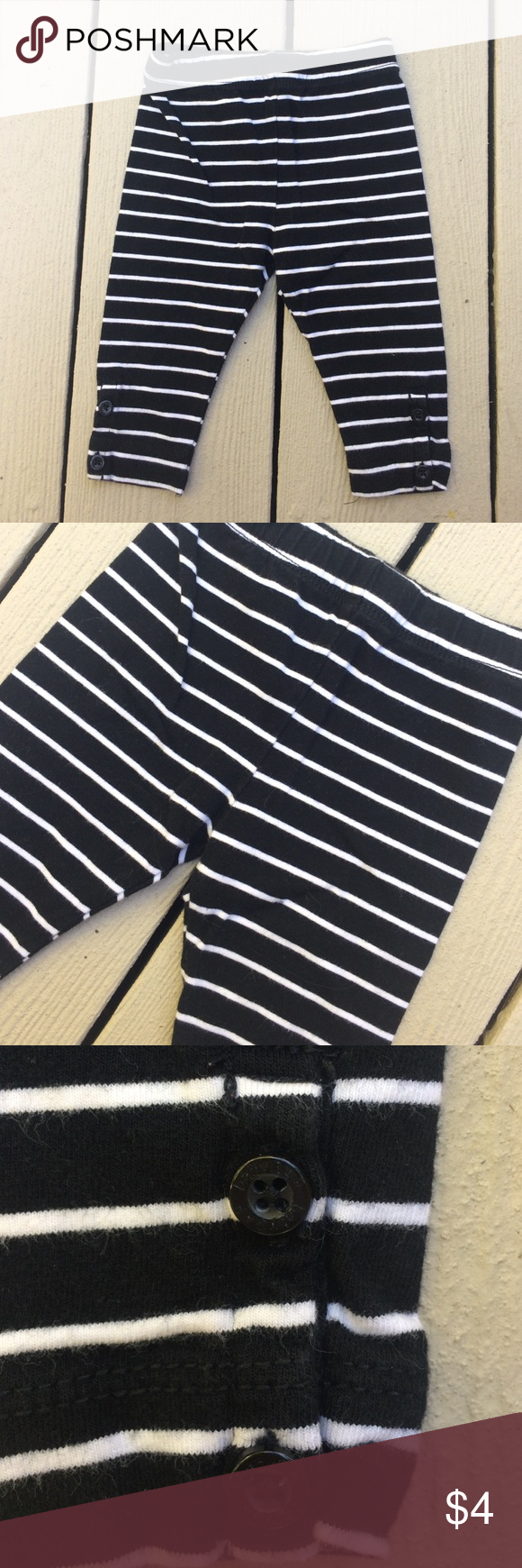 Baby Girl Leggings Black and white striped leggings. Great button detail on bottom leg. Bundle with my other items and save 💰💰💰 GAP Bottoms Leggings