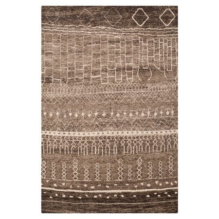 Add a pop of pattern to your living room or master suite with this artfully loomed rug, showcasing an abstract geometric motif in brown.   ...