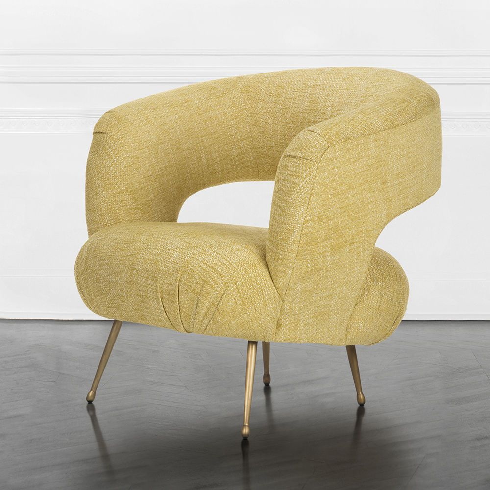 Kelly Wearstler Laurel Lounge Chair Features A Dramatic Open Back Upholstered Seat And Softly Rounded Silhouette