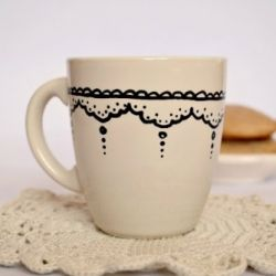 Easy to follow instructions on how to personalize a plain ceramic/porcelain mug! Cute doily pattern all around!