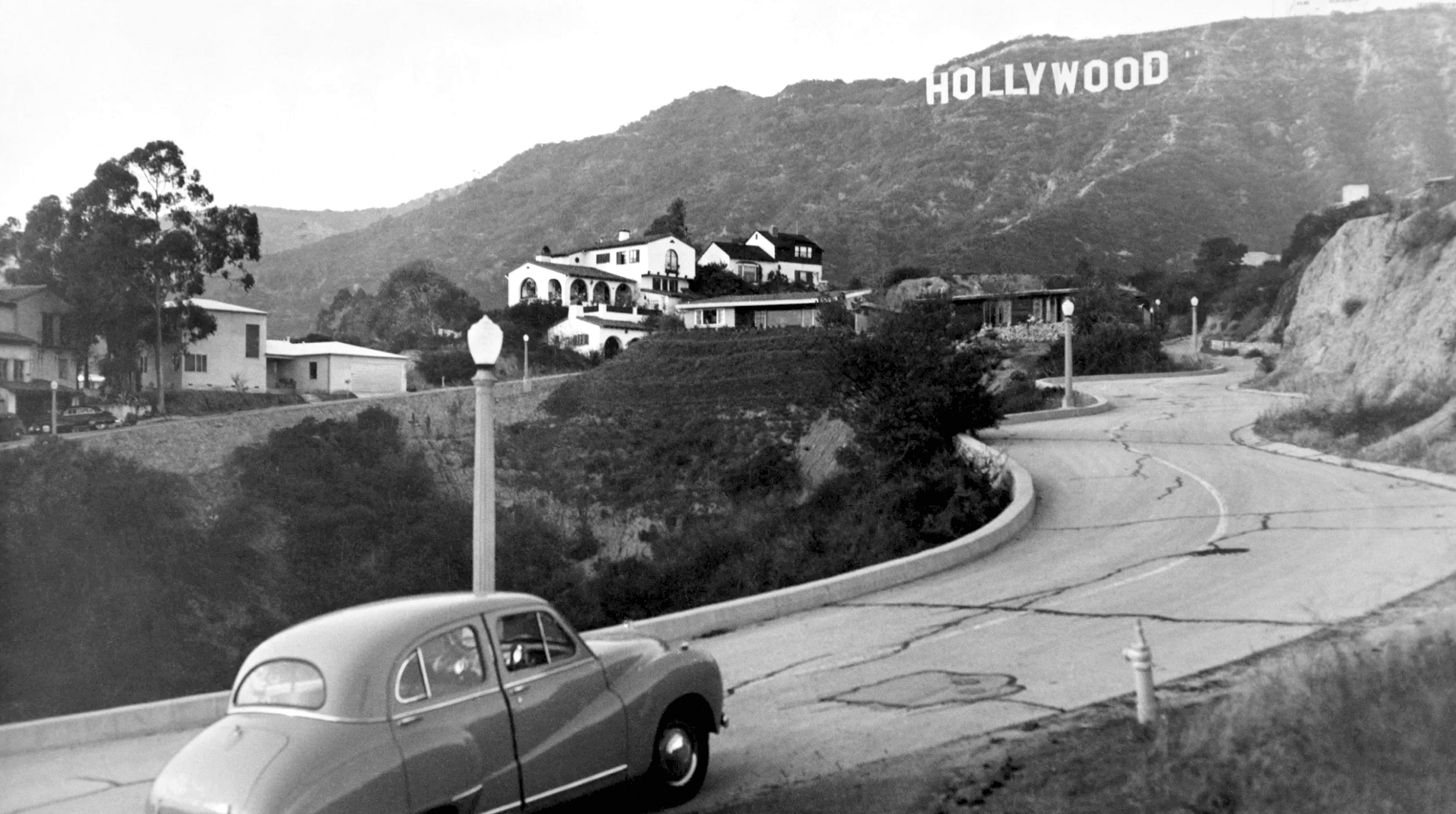 The view of the Hollywood sign from Deronda Drive in 1950, after the LAND  part was removed | Los angeles history, Hollywood sign, Tourist attraction