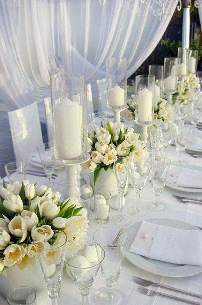 composition florale centre de table avec fleurs blanches pour votre table mariage