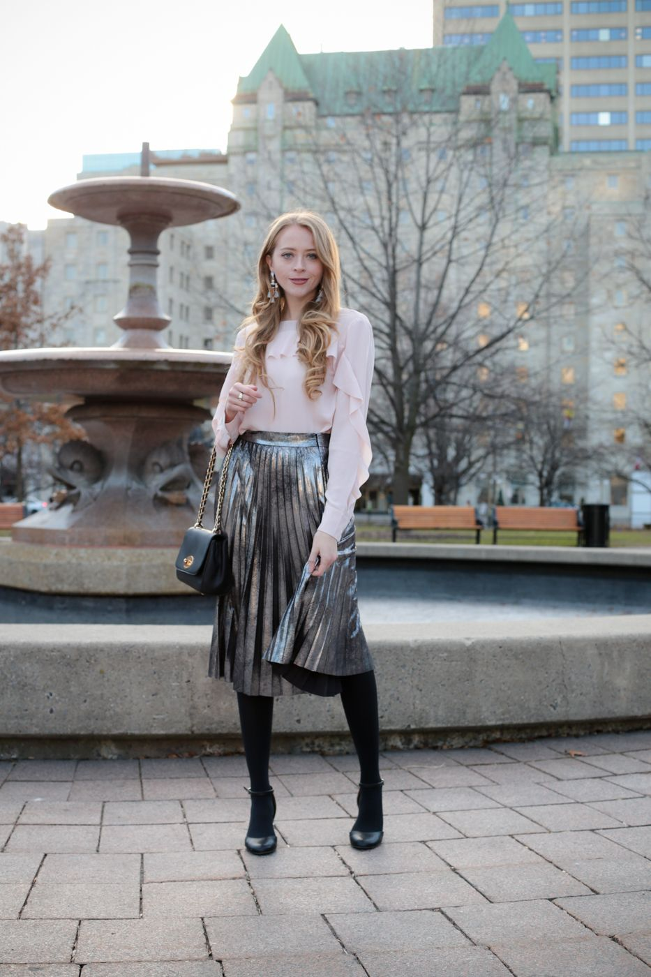 203054f491 One trend I can't get enough of is a metallic pleated skirt! I love the  modern twist on a wardrobe staple, and paired it with a pink ruffled blouse.
