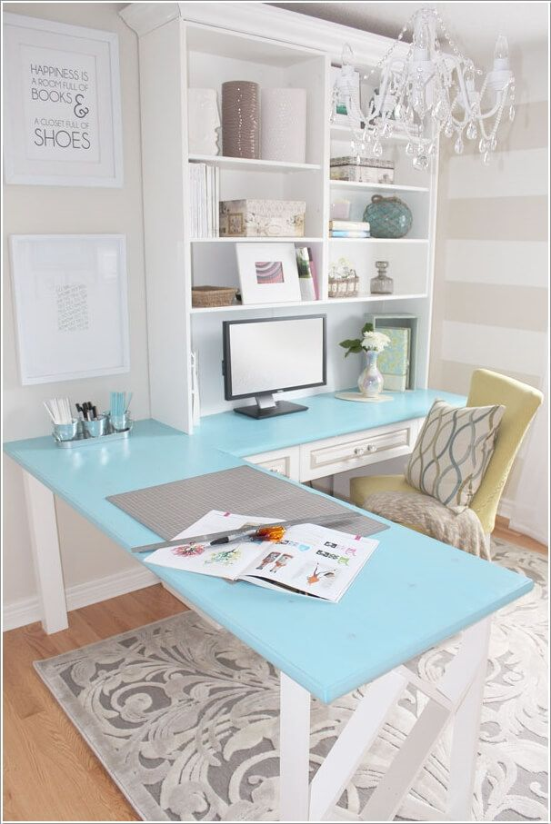 An L Shaped Colored Top Table With A Bookcase Above Offering Ample