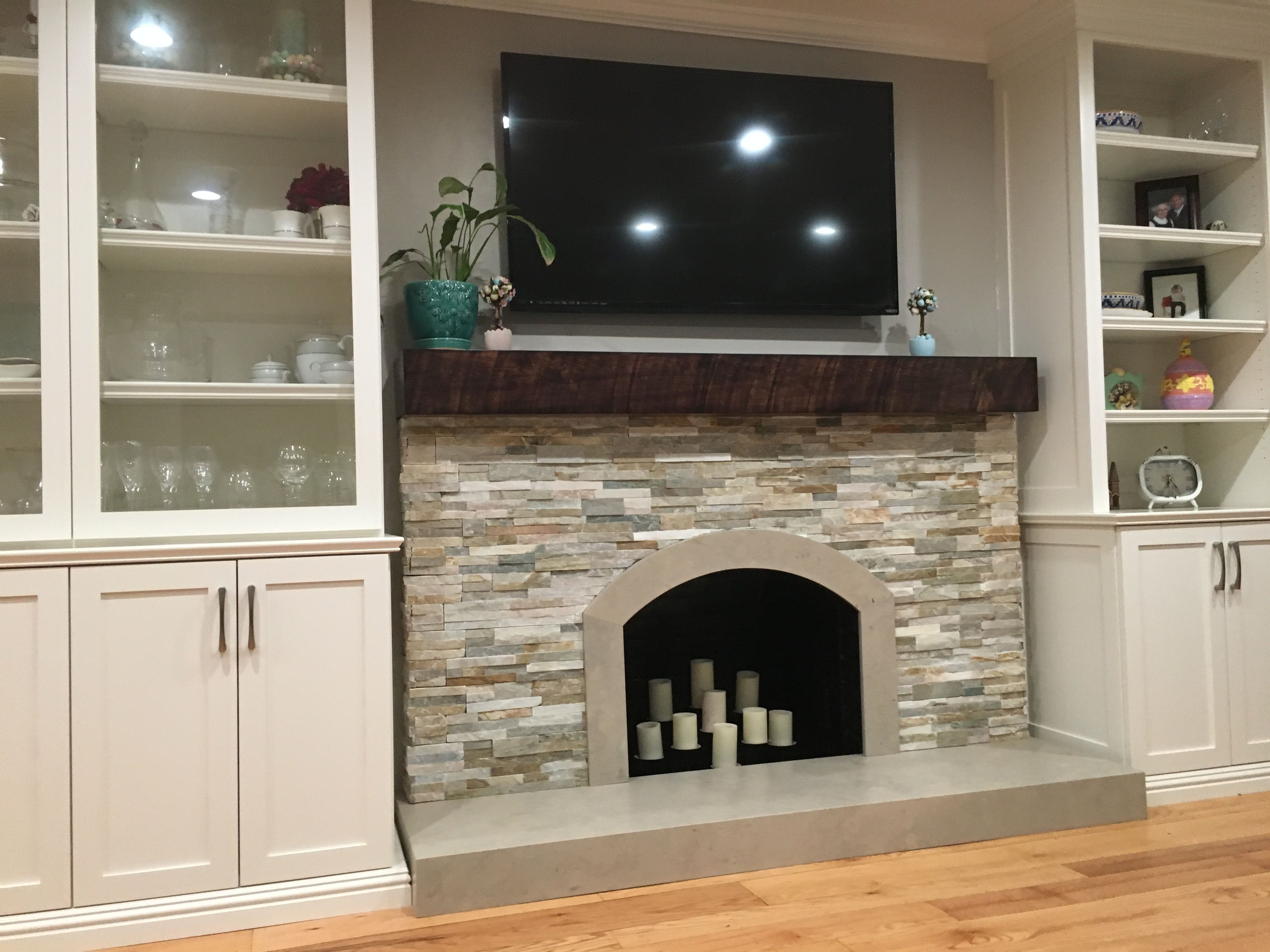 Stacked Stone With Limestone Hearth And Rustic Wood Mantle
