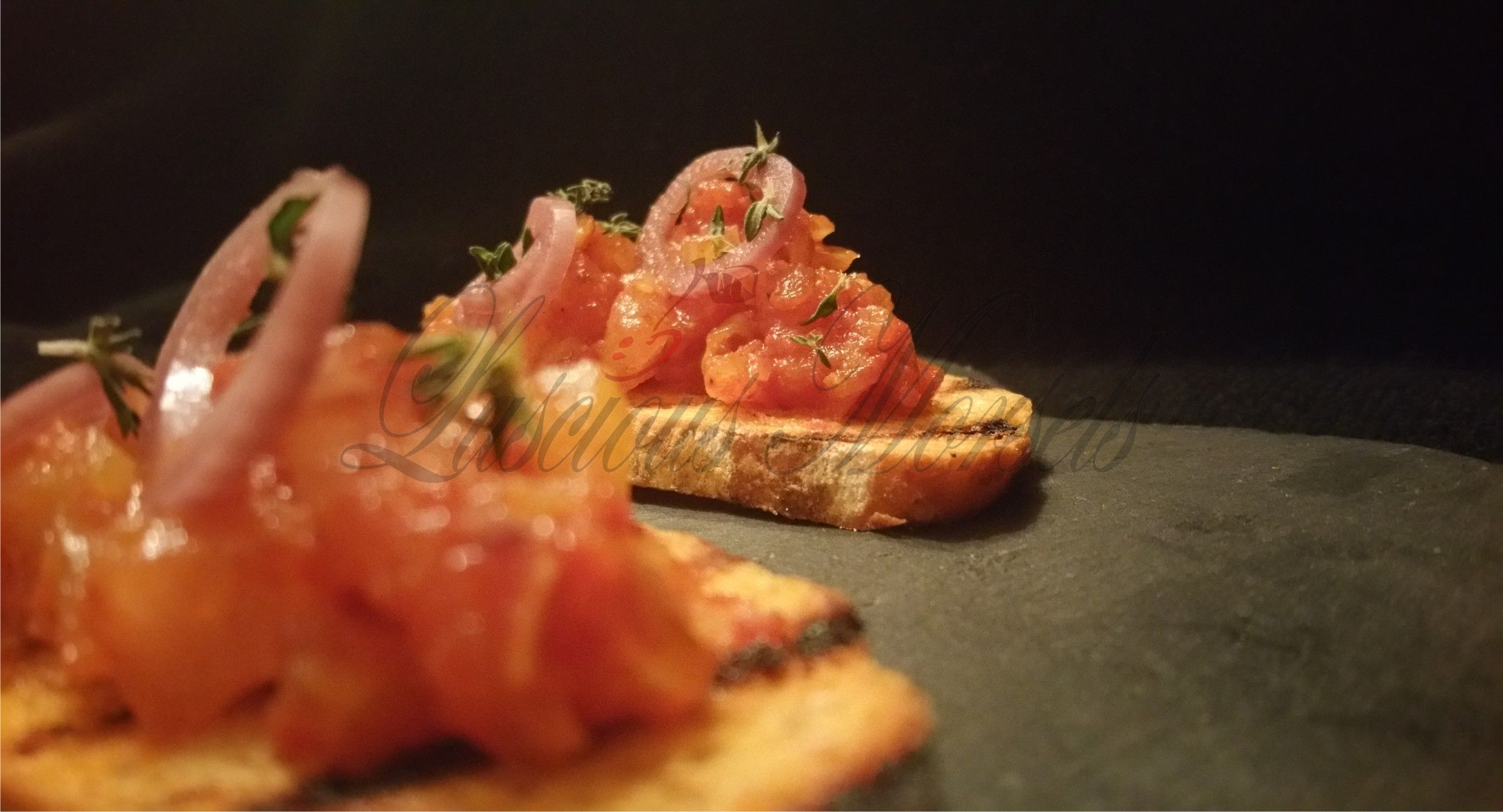 """Hand-made Sundried Tomato Crostini with Vierge & Pickled Red Wine Shallots"""""""