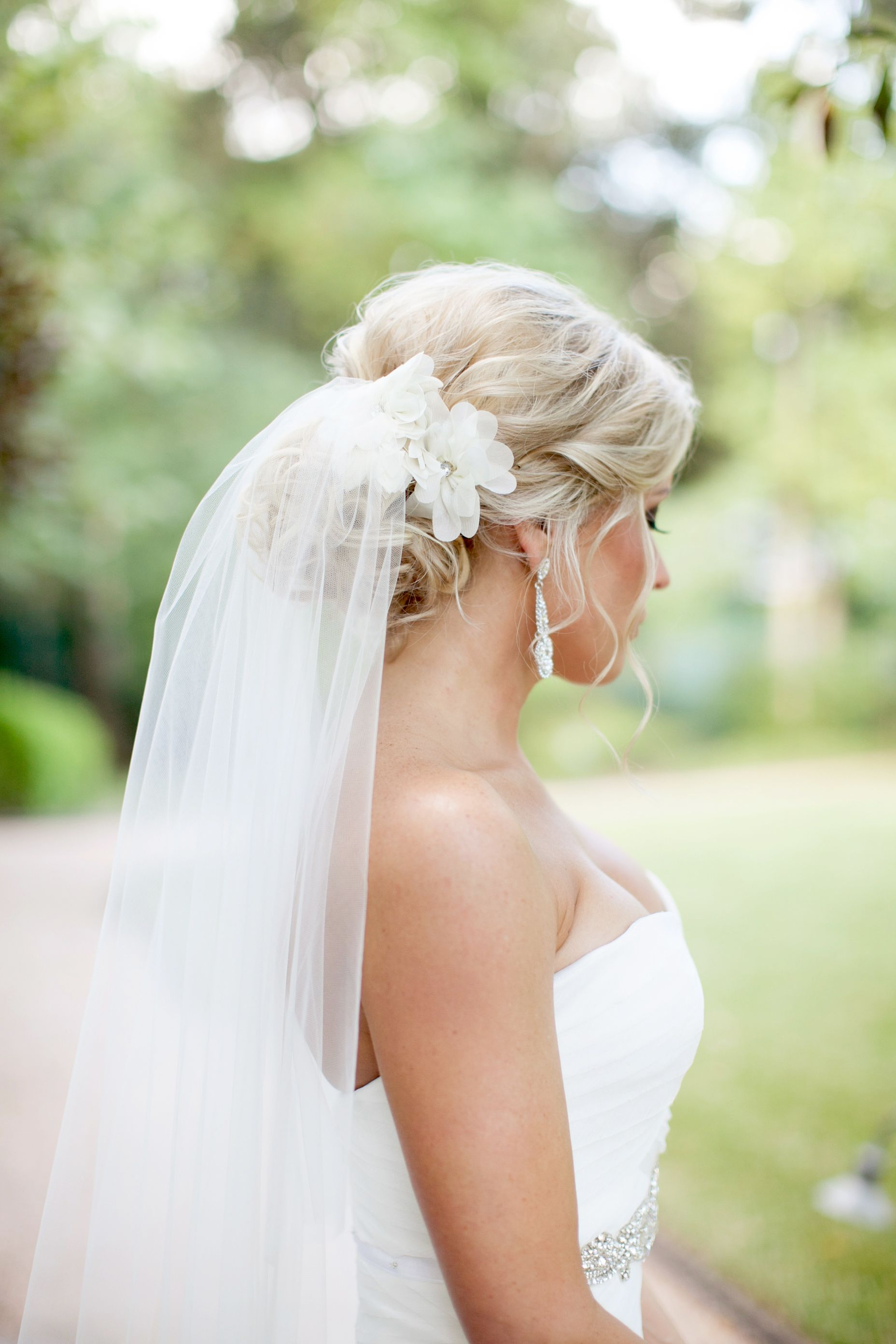 kelli wore her hair in a romantic bridal updo with a pair of