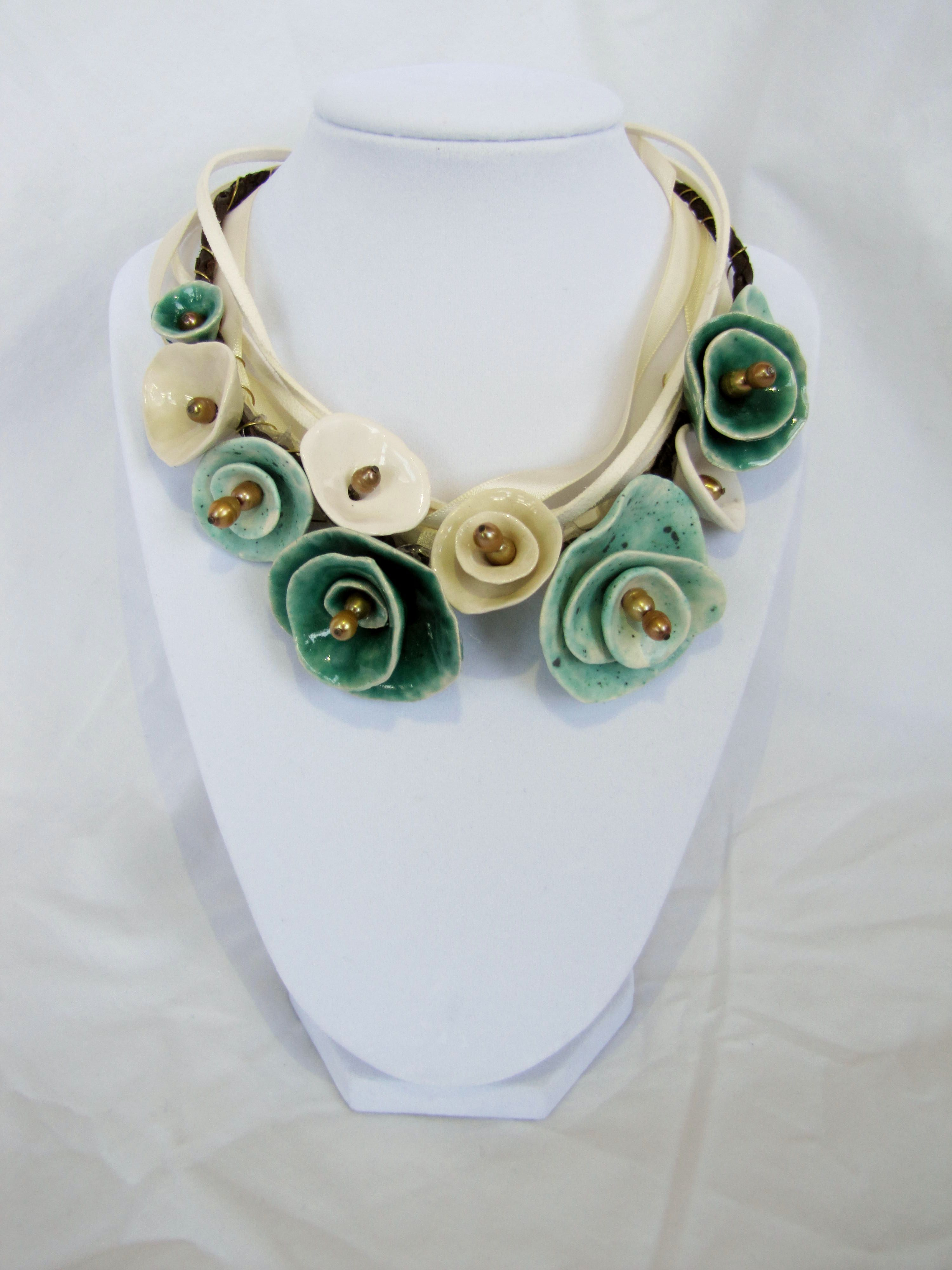Ceramic turquoise flower necklace--how 'bout out of felt? Or even scraps of silk--ooooo, now we're talking . . .