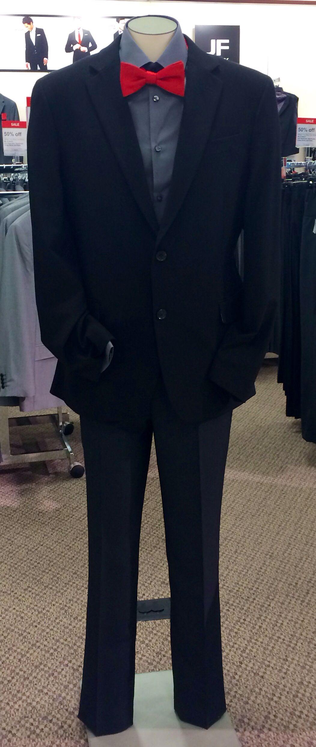 Black jacket grey shirt red tie