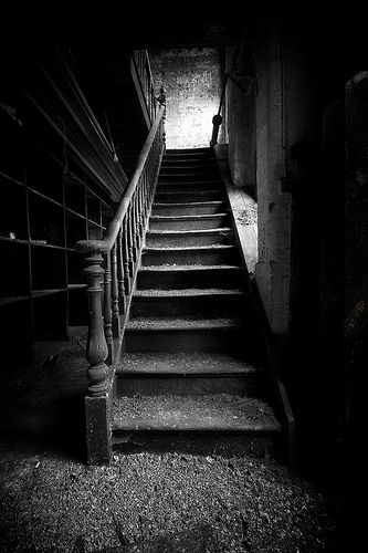 """""""...foot of our stairs        ...foot of our stairs    Exploration of an abandoned tool works, est 1836.    It looks a bit ominous, but this wonderful building is anything but...""""  ~James Drury"""