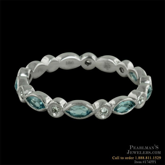 A captivating aquamarine and diamond eternity ring in 18kt white gold. This ring features .86cts in marquise cut aquamarines. 2.5mm width. Also available in platinum and different gemstone variations.