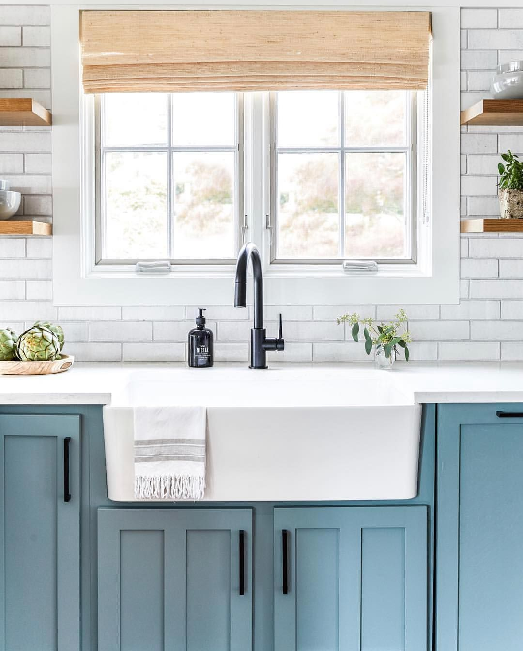 Robin's egg blue kitchen with white farmhouse