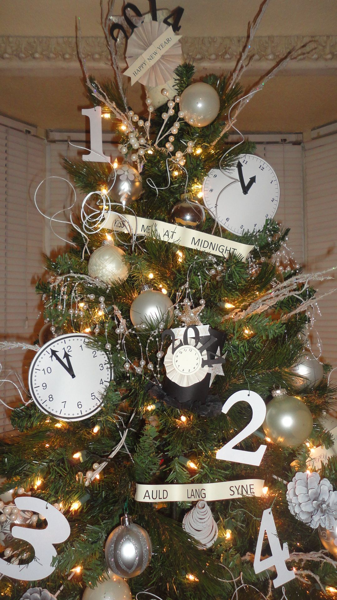 after christmas i turned my tree into a new years eve tree by adding clocks sayings count down num new years eve day new years eve decorations new years tree tree into a new years eve tree