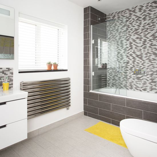 Modern Bathroom With Grey Mosaic Tiles And Yellow Bath Mat