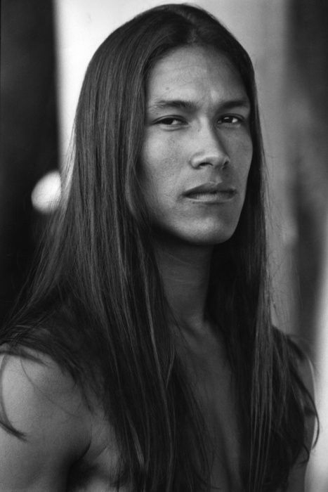 Straight long hair for man. A Native American man or from the ...