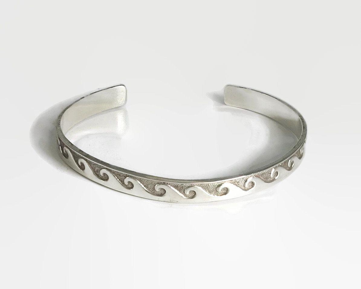 ee3520edfea Sterling silver cuff bracelet with wave pattern
