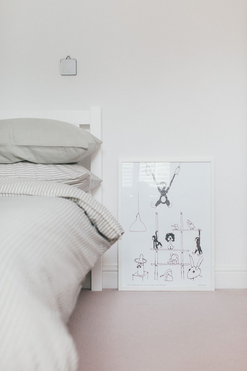 a modern neutral millennial pink bedroom for a little boy pink
