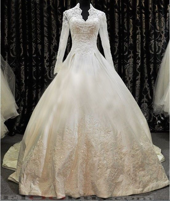 8aca3603cf9eb princess cut wedding dress with long sleeves - very fairytaleish. I  absolutely LOVE the poofy skirt, collar cut and stunning detail