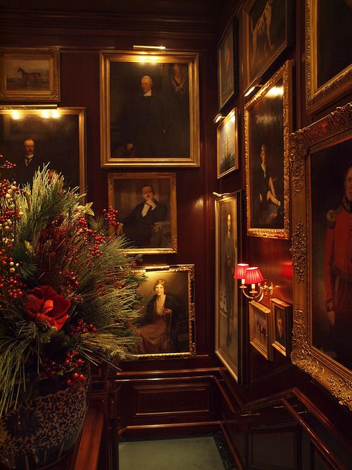 Wooden staircase, gold framed portraits, red lampshades - Ralph Lauren, Michigan Avenue