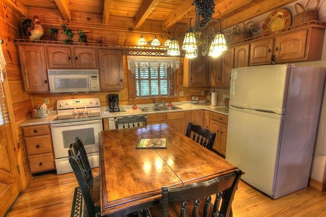 This kitchen could give rivalry to that of a professional chef's. Complete with a dishwasher to clean up all your messes, this kitchen is absolutely perfect for any family vacation.