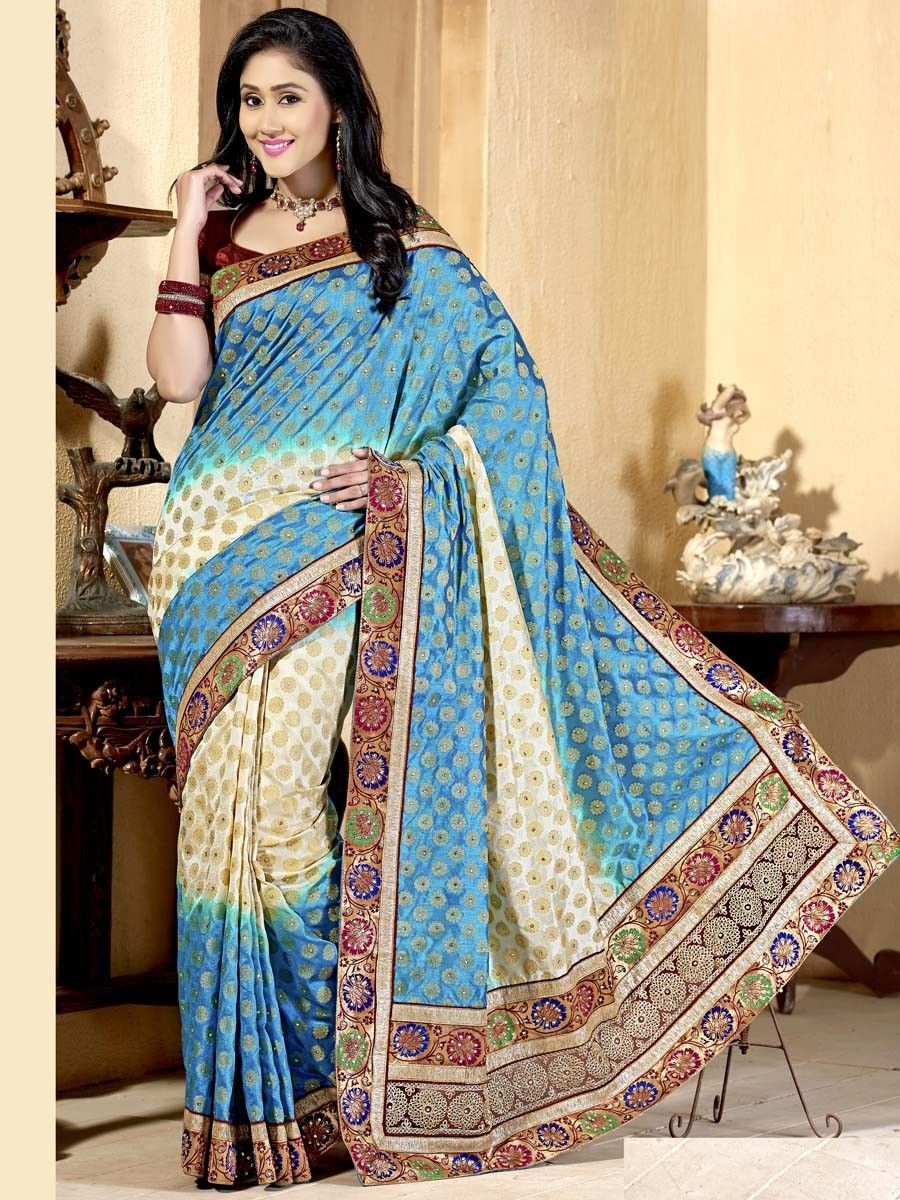 Radiant blue, off white color art silk saree with fancy patch border and kundan. Item Code : SUM7003  http://www.bharatplaza.com/new-arrivals/sarees.html