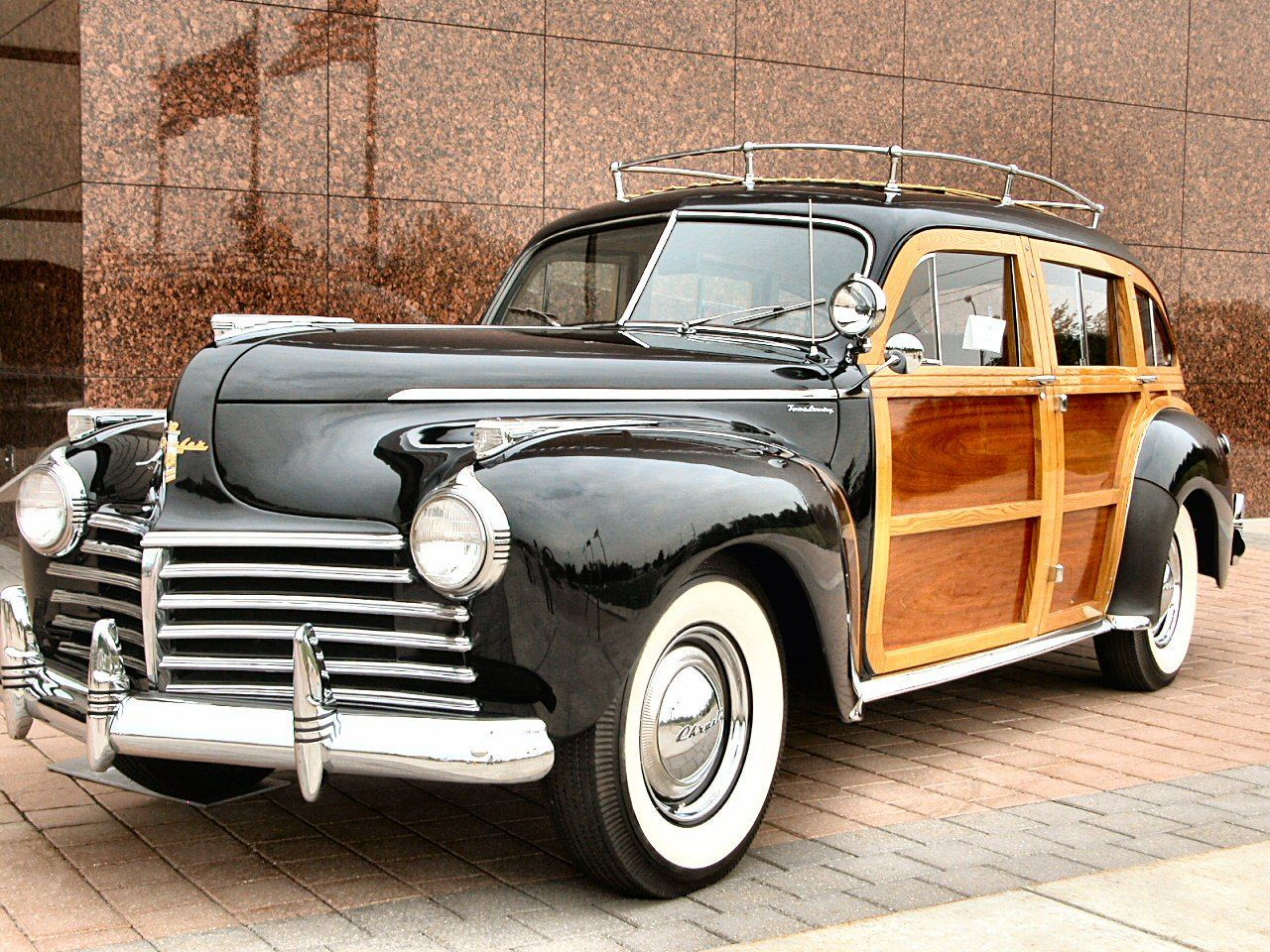 1941 chrysler town amp country woody station wagon parked wpc museum brick porch black lfvl n