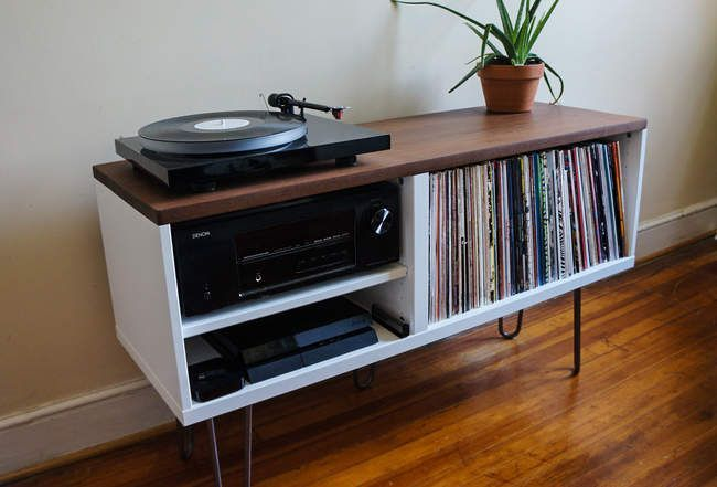 Mid-Century Record Cabinet Price: Under $100 Materials Needed: 1 BESTÅ shelf unit, long slab of dark scrap hardwood, 4 hairpin legs, wood glue How It's Done: Assemble the shelf as you would normally, leaving the right side's middle shelf out. From there mount it horizontally on the set of hairpin legs, and glue the slab of scrap wood to the top.