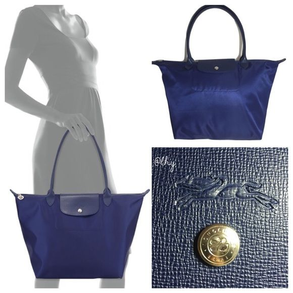 """❌SOLD❌LONGCHAMP NEO LE PLIAGE LARGE TOTE (NAVY) Authentic like new Longchamp New le Pliage Tote in large size. Approx 11.75""""W x 12.25""""H x 7.5""""D. Strap drop 8"""". Navy nylon with tonal navy leather trim. Zip top closure with leather flap. Nickel hardware. Interior slip pocket. Water resistant lining. ❌❌NO TRADES NO PP PLEASE DO NOT ASK❌❌tradesy Longchamp Bags Totes"""