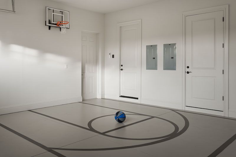 The garage in 7846 Palmilla Ct doubles as an indoor basketball half