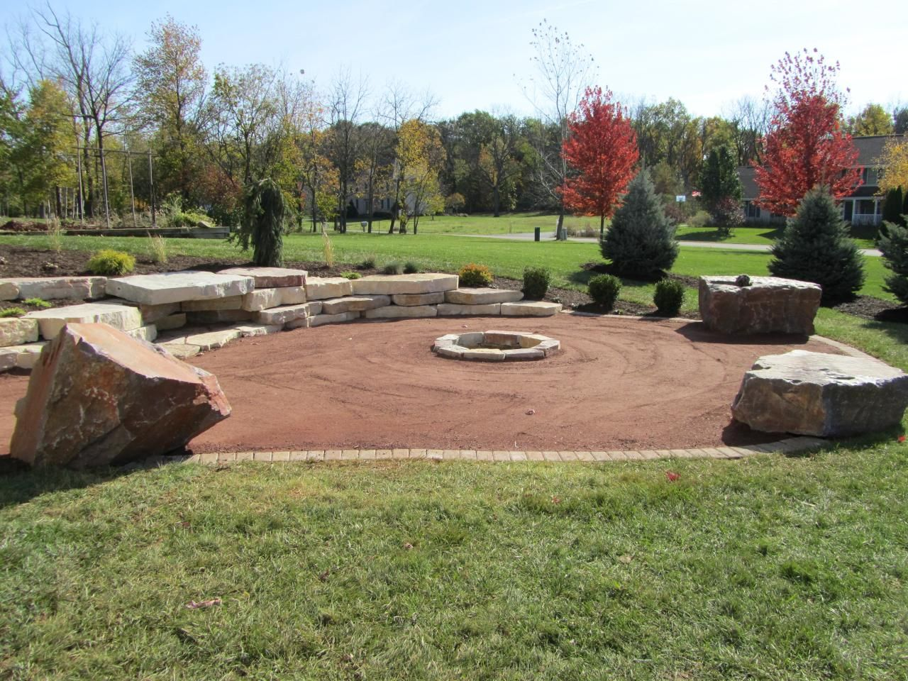 Dg patio and fire pit area with stone tread retaining wall for Surface design landscape