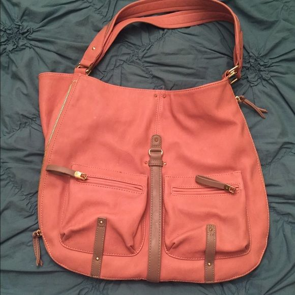 Big Buddha faux leather handbag Awesome bag in like new condition! Perfect colors for spring! Not actually that vibrant of a pink- more light, salmon colored with tan and gold zipper accents. Tons of room inside bag for storage. Sides zip/ unzip to change the shape/ accommodate more storage! Enjoy! :) Big Buddha Bags Shoulder Bags