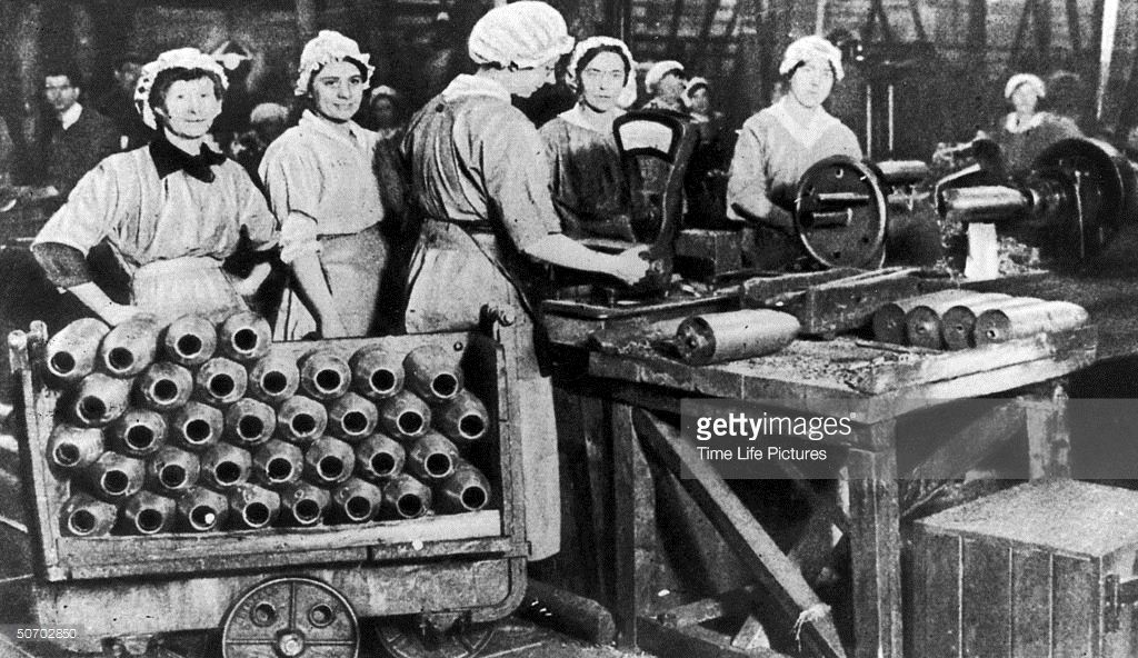 British women working in arms factory weighing shells