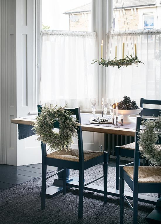 Artful touches, such as mini wreaths attached to the backs of chairs with ribbon or gardening wire, and a brass candle halo entwined with foliage, are great ways to bring a natural feel to the dining table. Homes & Gardens. http://www.hglivingbeautifully.com/2015/12/16/the-look-simple-festive-touches/