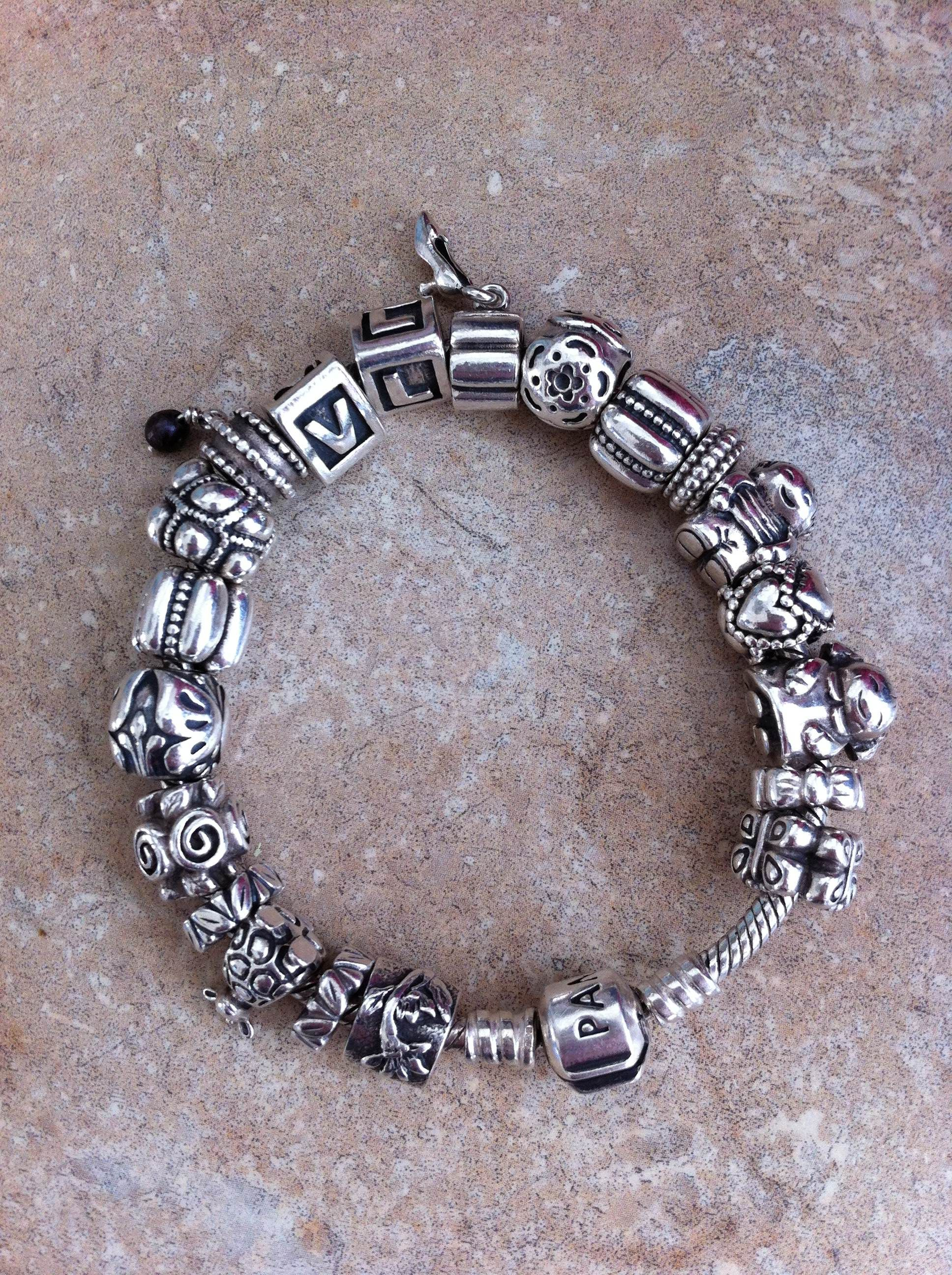 e29570564 Full silver PANDORA bracelet; one of mine has a solid gold heart ...